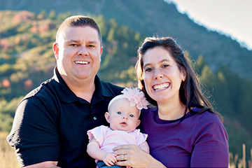 Dr. Linford, his wife, Lori, and baby Lloklan.